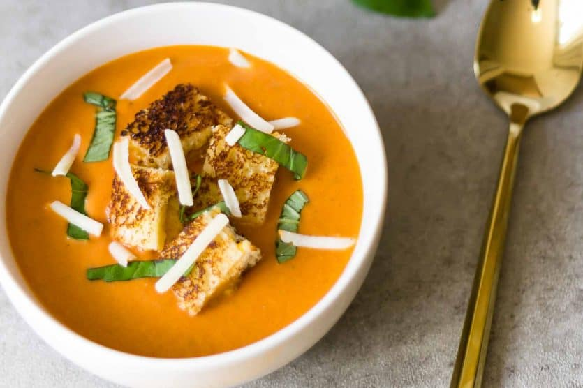 This creamy tomato soup recipe with grilled cheese croutons is so easy and amazing!  It's better anything you'll order at a restaurant, and the whole family will love it.