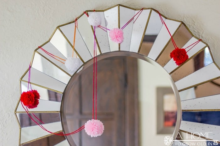 Check out these 3 easy DIY Valentine's Day projects that will liven up your entryway or mantle and won't break your budget. I love this pom pom garland!