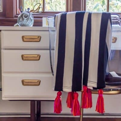 Turn a versatile and inexpensive Ikea blanket into a must-have home decor accessory! It's such an easy update that makes quite a statement. Click to learn how!