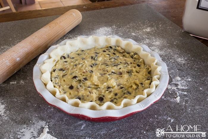 This salted chocolate chip cookie pie is the perfect dessert because it's great for any occasion. It's sure to impress for a holiday get-together, but works just as well for a low key family movie night treat. The sea salt helps balance the sweetness of the pie to make an absolutely decadent dessert!