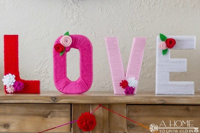 Yarn Wrapped Love Letters are a great DIY project to add to your mantle or entry table! Includes the instructions on how to make felt flowers.