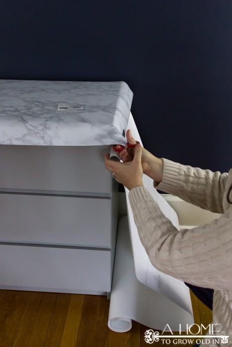 removing excess contact paper after applying it to top of ikea dresser