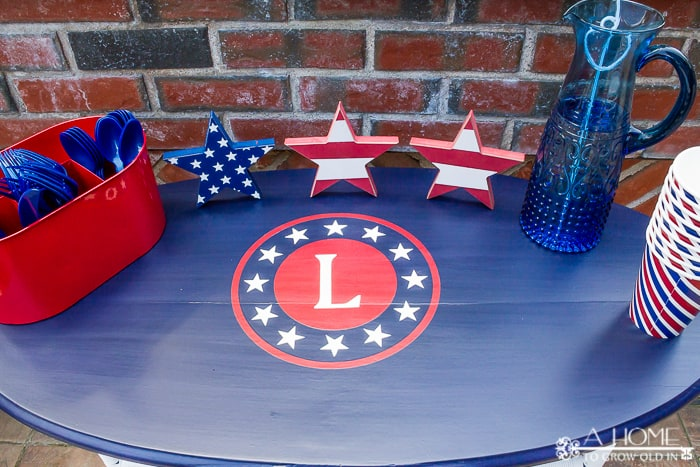 A table decorated with red, white, and blue with a patriotic svg file used as a stencil