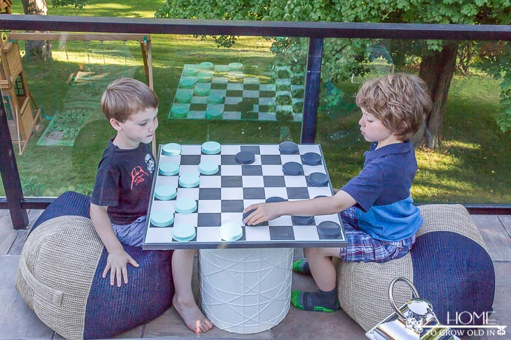 children playing checkers outside