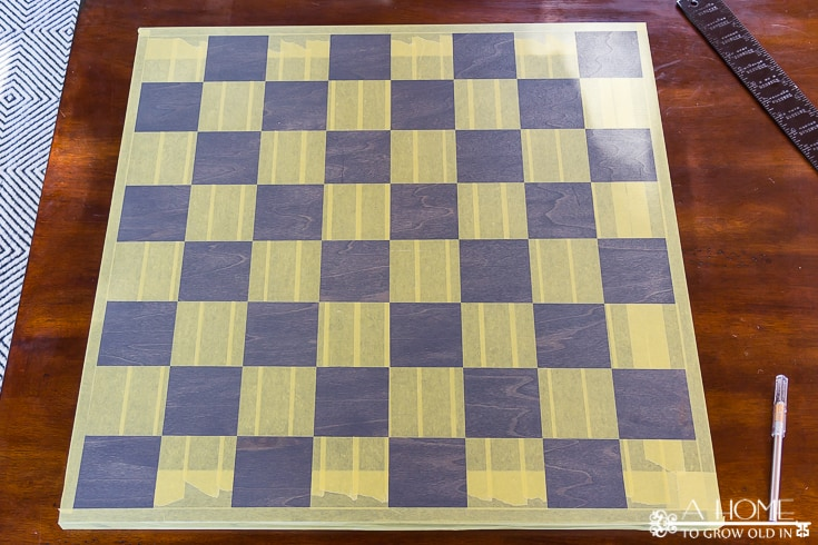stained wood that is taped off for checkers