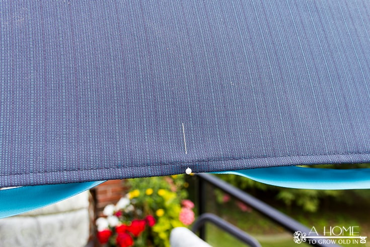 This tasseled outdoor umbrella is a great way to get a high-end look for less! It's an easy and inexpensive DIY that saved me over $800!