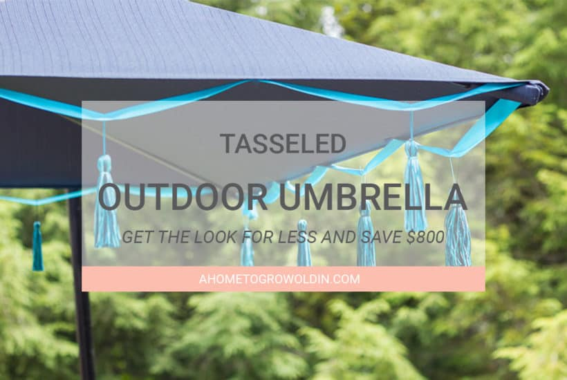 This tasseled outdoor umbrella is a great way to get a high-end look for less! It's an easy and inexpensive DIY that saved me over $800 off of the Frontgate version! Pin it now so you'll have it later!