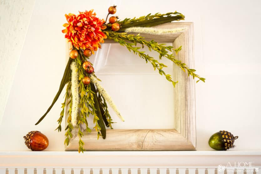 square fall pool noodle wreath on a fireplace mantel