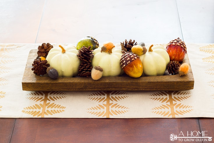 I love this simple fall centerpiece for the dining room! I can't get over how much great fall home decor inspiration there is here! Definitely pinning for later!