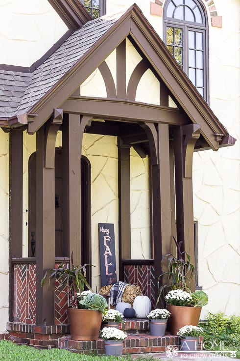 I love this neutral fall porch with white mums and shades of gray and copper! You'll want to pin this one!