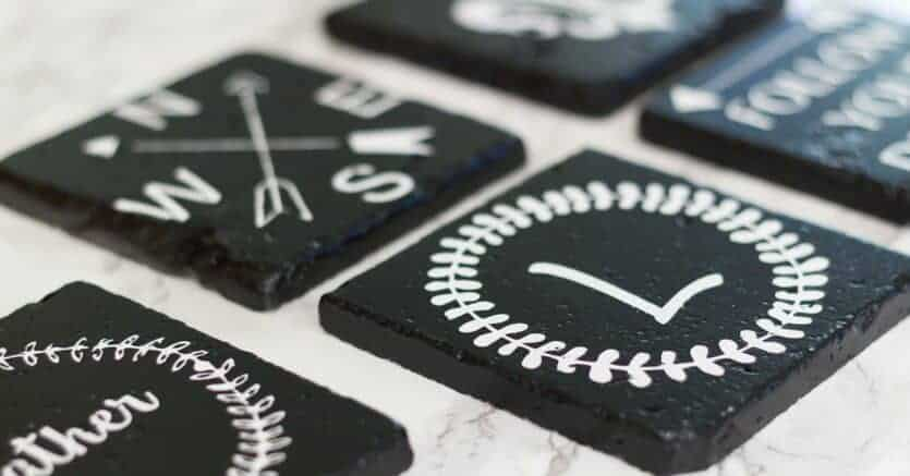 black DIY farmhouse style drink coasters on a marble background