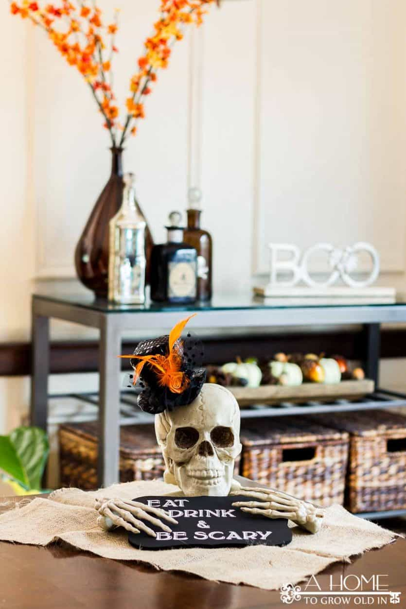 This easy DIY Halloween party decoration will be the perfect centerpiece for your table at your next indoor scary gathering. You won't believe how simple it is to make! #halloween #halloweendecor #diy #homedecor #halloweendecorations #decorations #ahometogrowoldin