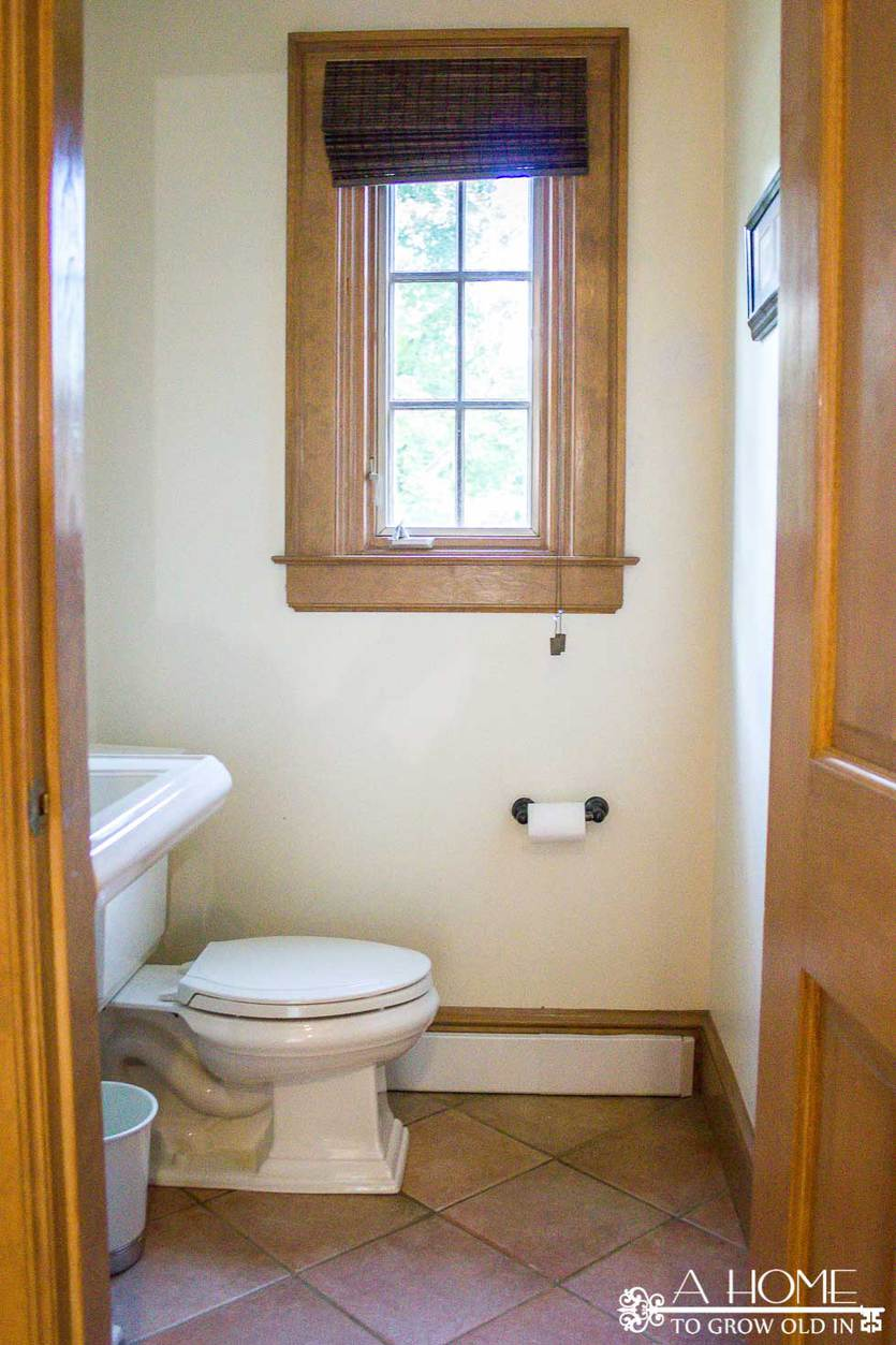 This transitional farmhouse powder room makeover is full of amazing DIYs like faux cement tiles and wooden planked walls! Great ideas for projects you can do yourself. You won't believe the transformation!