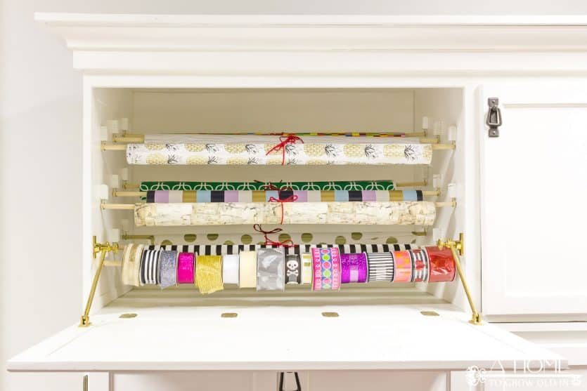 How to make a gift wrapping station from an old armoire a home to its easy to repurpose an old armoire into a beautiful and organized gift wrapping station for solutioingenieria Choice Image