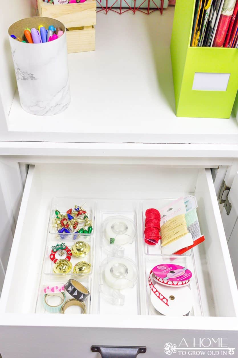 It's easy to repurpose an old armoire into a beautiful and organized gift wrapping station for your craft room! Lots of ideas on how to DIY this yourself!