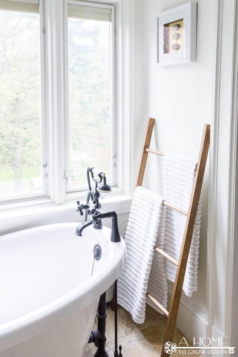 DIY ladder towel rack with clawfoot bathub