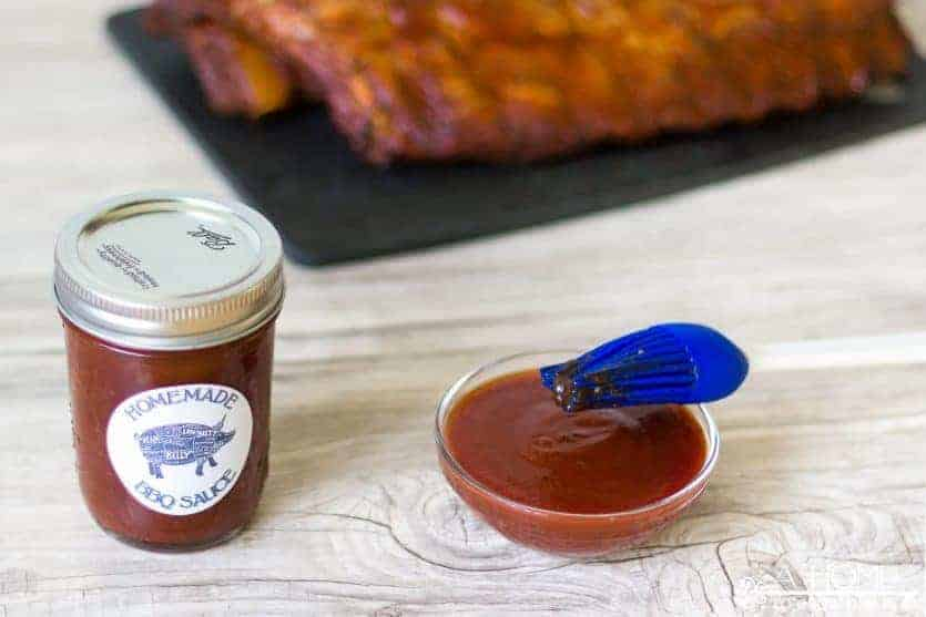 An easy sweet and spicy homemade BBQ sauce recipe that works well with all beef, pork, and chicken. You'll also want to print out these cute labels for your jars. These jars would make a great Father's Day gift!
