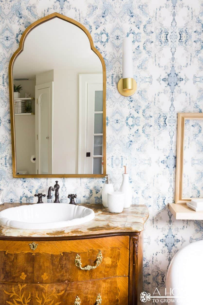 """You won't believe the transformation in this easy bathroom makeover! It went from """"blah"""" to modern and fresh with just a few easy DIY projects."""