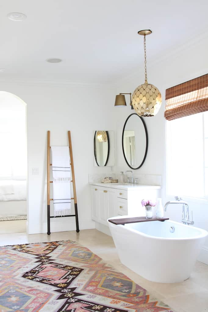 The Latest Bathroom Design Trends Round Mirrors Bold Fixtures - Round gray bath rug for bathroom decorating ideas
