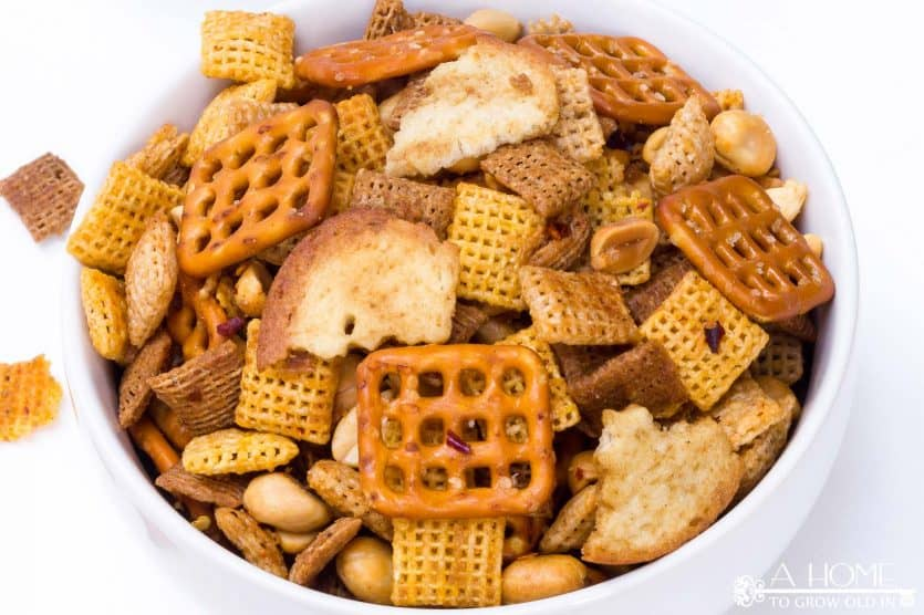 Looking for the ultimate snack recipe for your football watching party? This spicy Sriracha Chex mix recipe has just the right amount of heat! It is sure to be a game-day favorite.