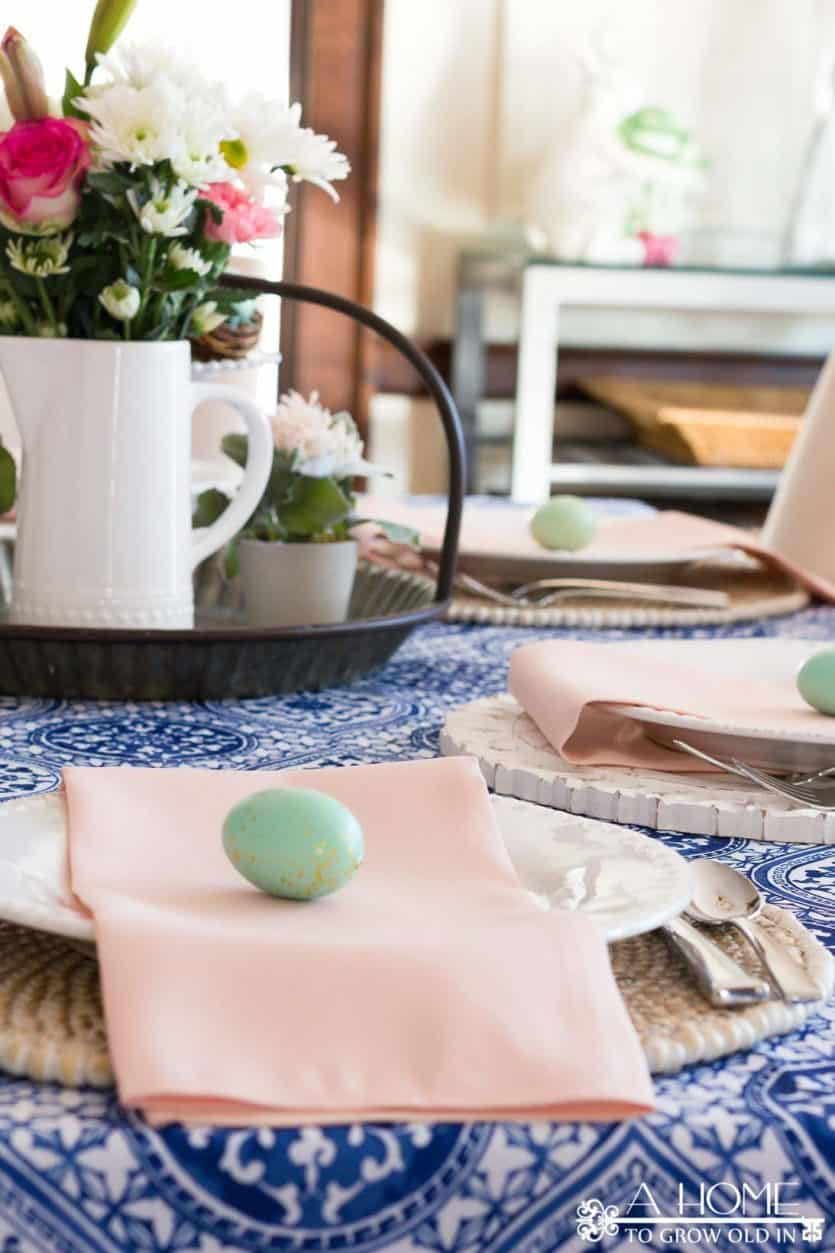 This cobalt blue and blush pink spring tablescape will give you lots of inspiration to get your dining room ready for your spring entertaining or Easter brunch. #spring #springdecor #diycrafts #easter #tablescape #springtablescape #easterdecor #eastertablescape #springdiningroom