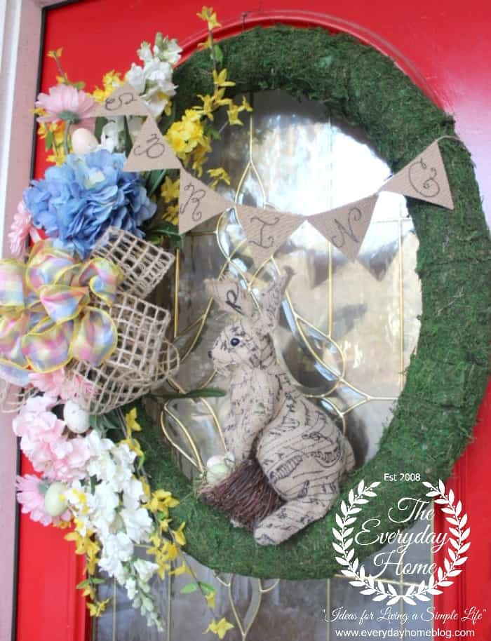 moss covered wreath with bunny made from a pool noodle