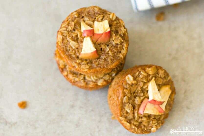 A top down view of three cinnamon apple oatmeal muffins