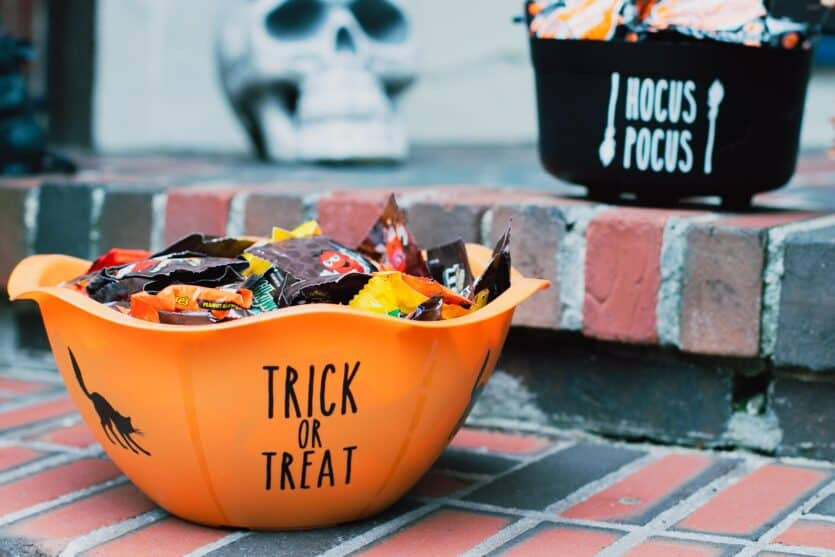 two Halloween candy bowls filled for trick or treaters