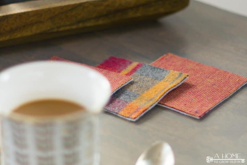 plaid flannel drink coasters on a coffee table with a cup of coffee