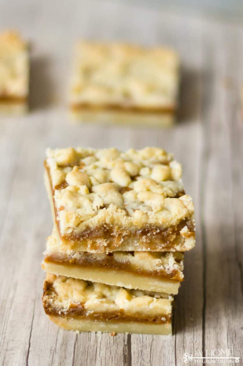 three salted caramel butter bars with a couple out of focus ones in the background