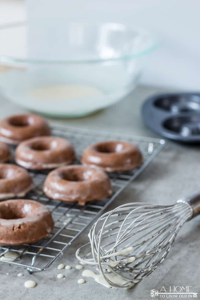 baked chocolate glazed donuts with whisk