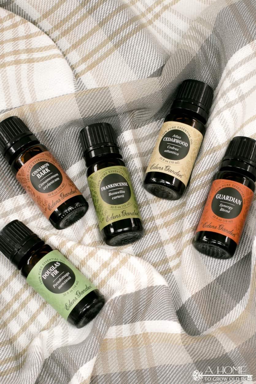 essential oils on a plaid blanket