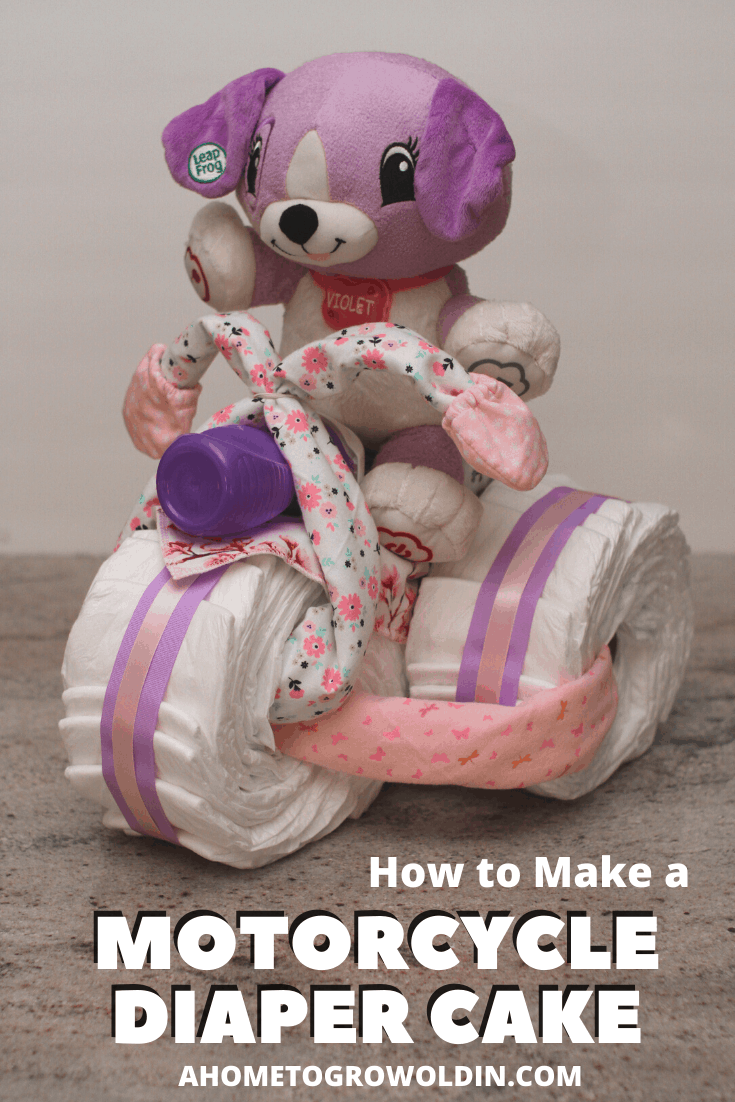 three wheeled motorcycle diaper cake for a baby girl