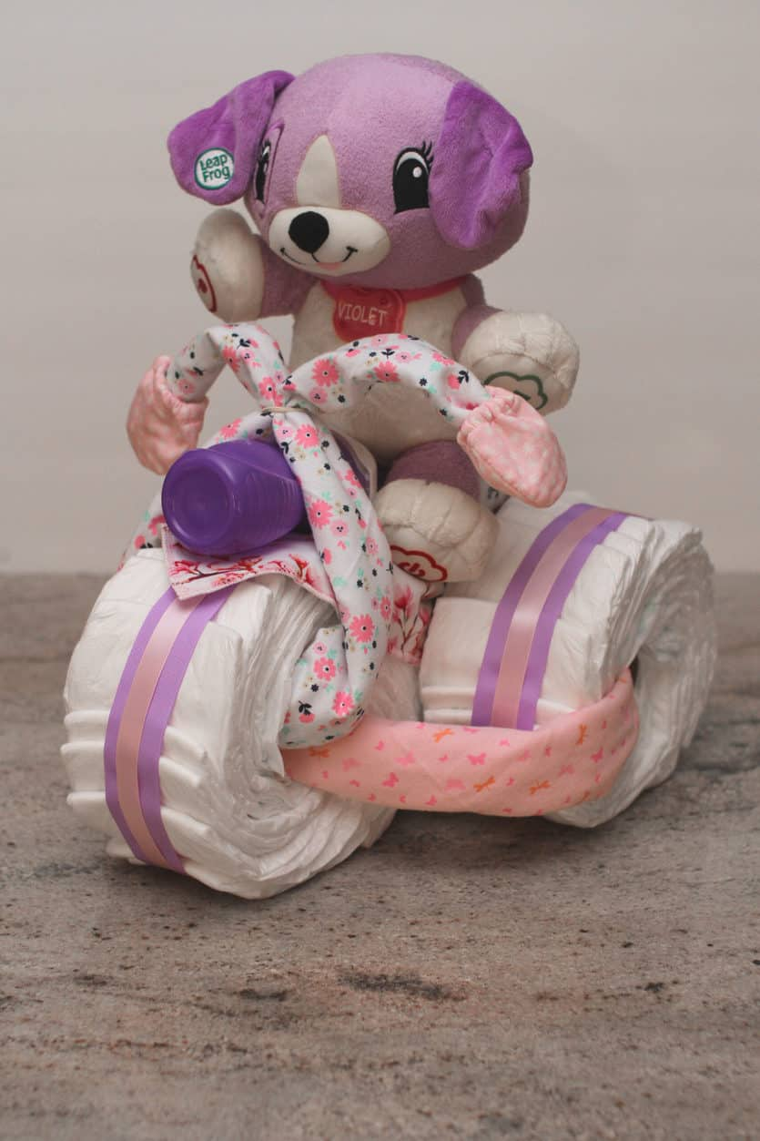 stuffed animal on motorcycle diaper cake