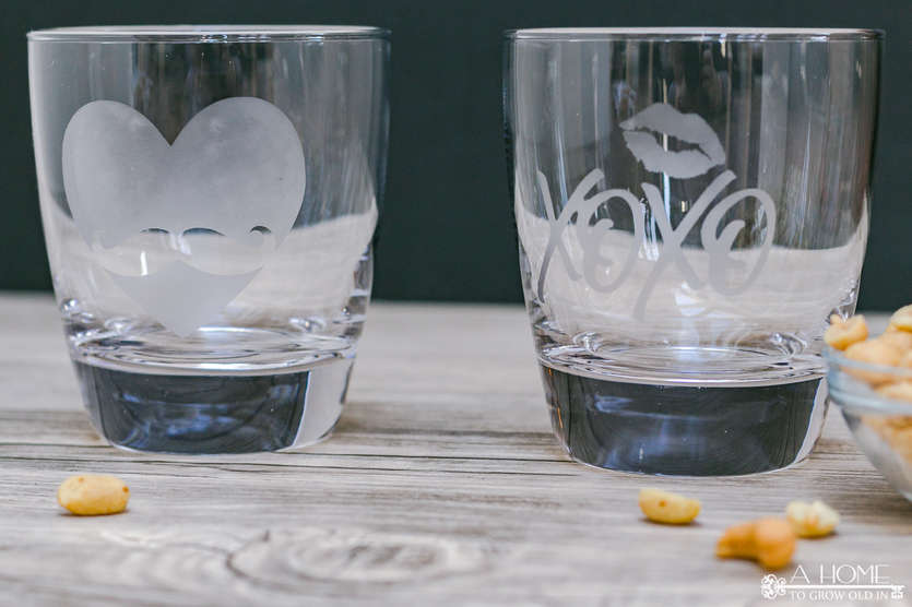 two etched glass whiskey tumblers