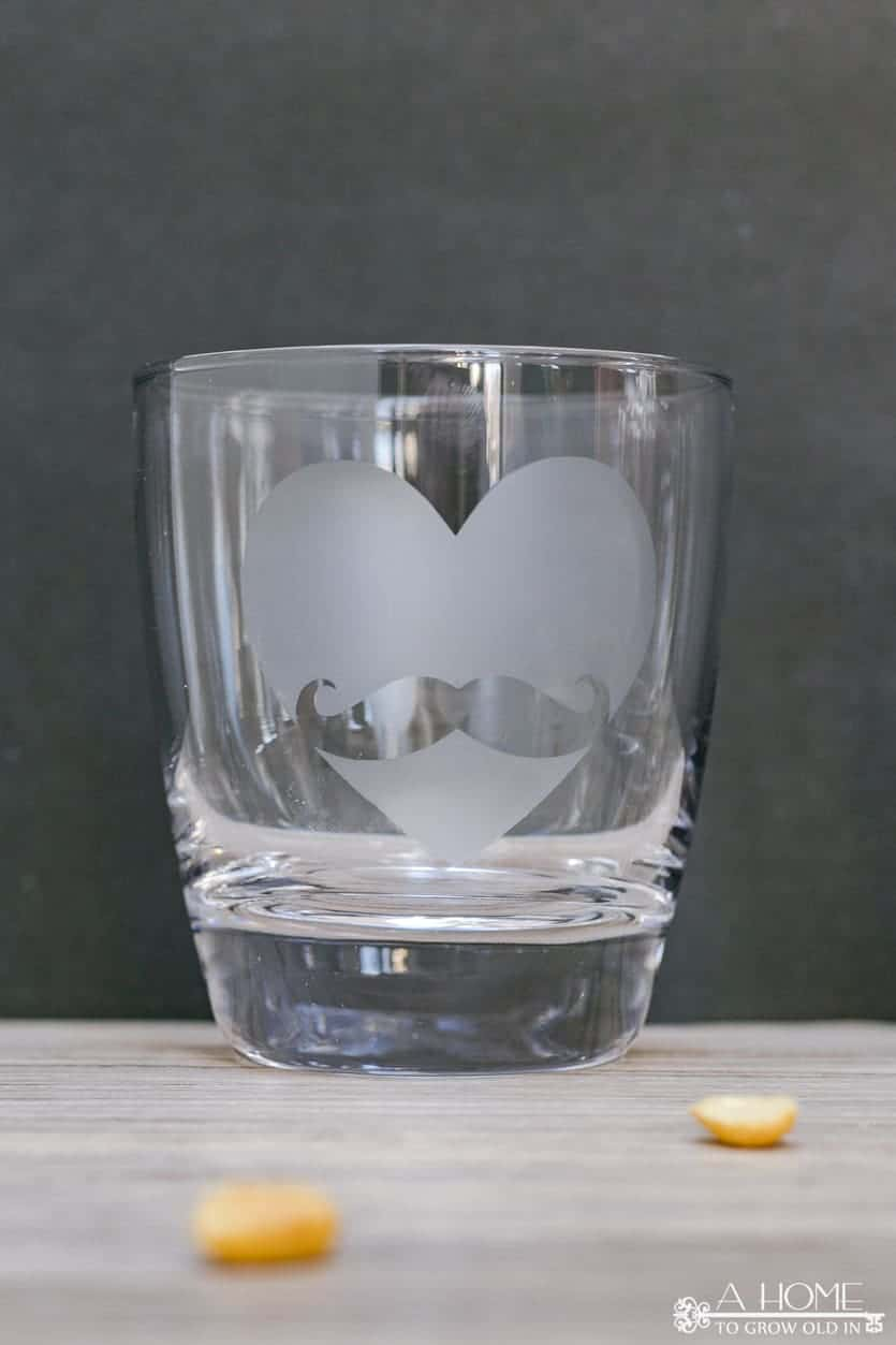 whiskey tumbler with heart mustache etched on it