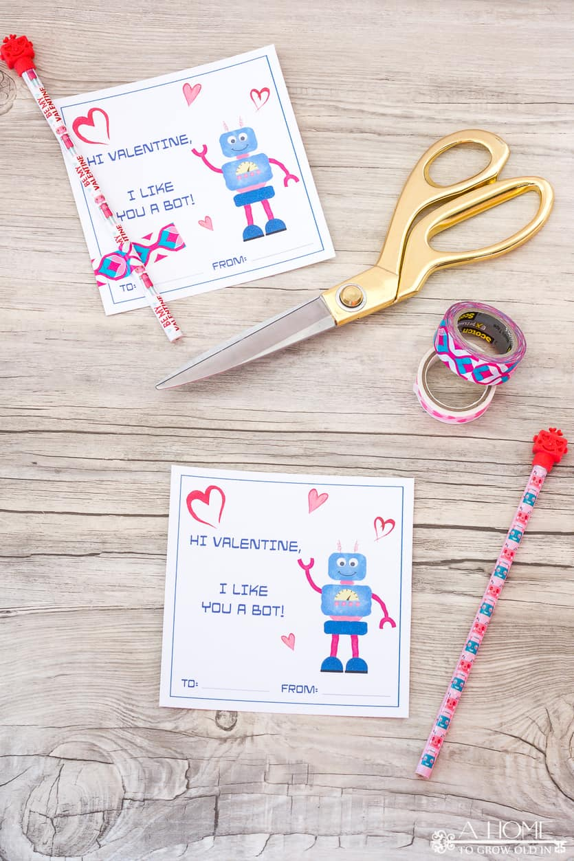 robot valentines cards with scissors and washi tape on a wooden background