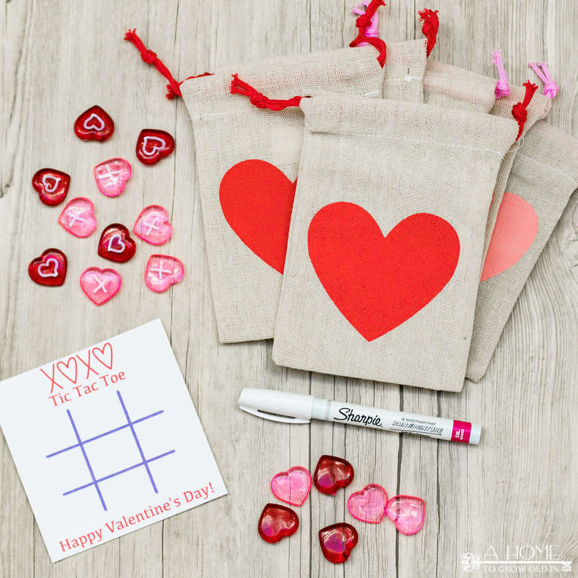 heart gift bags with a tic tac toe Valentine card and heart game pieces