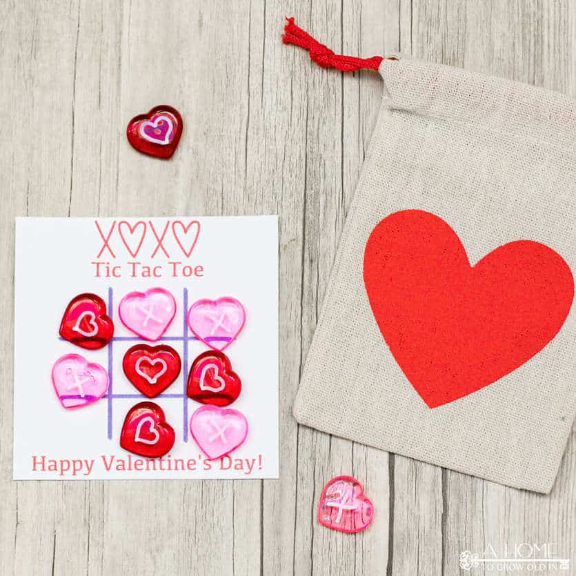 playing a DIY tic tac toe game for Valentine's day