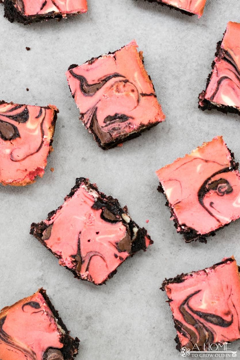 several pink cheesecake marbled brownies