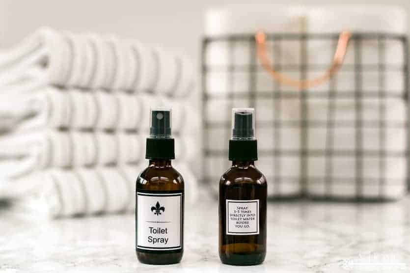 two bottles of essential oils diy toilet spray