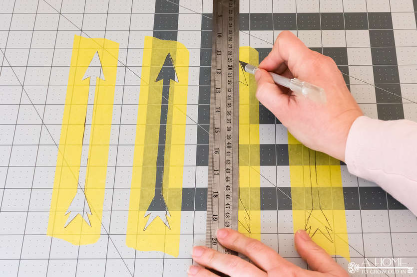 creating arrows out of painter's tape to use as a stencil