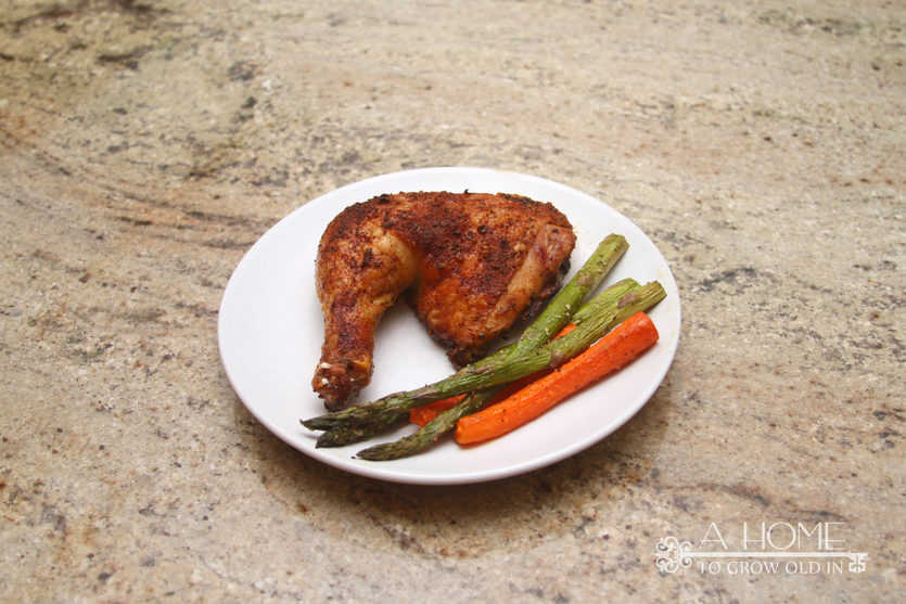 plated roasted chicken with veggies