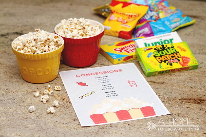 popcorn and candy with a concessions sign