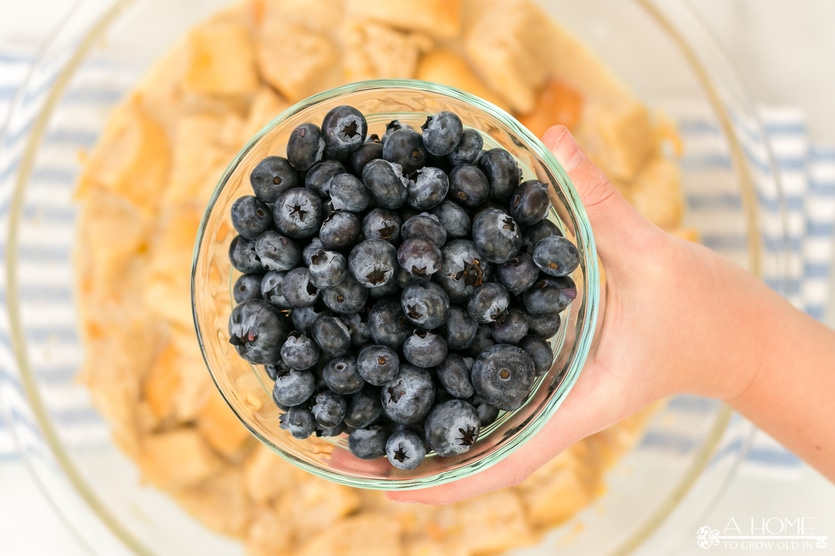 blueberries getting added to bread pudding
