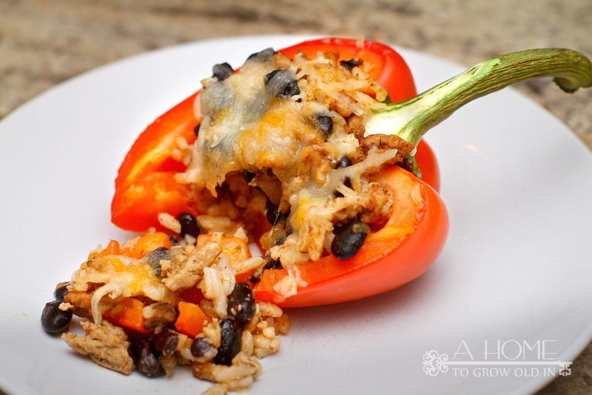 bite taken of a turkey stuffed bell pepper with cheese