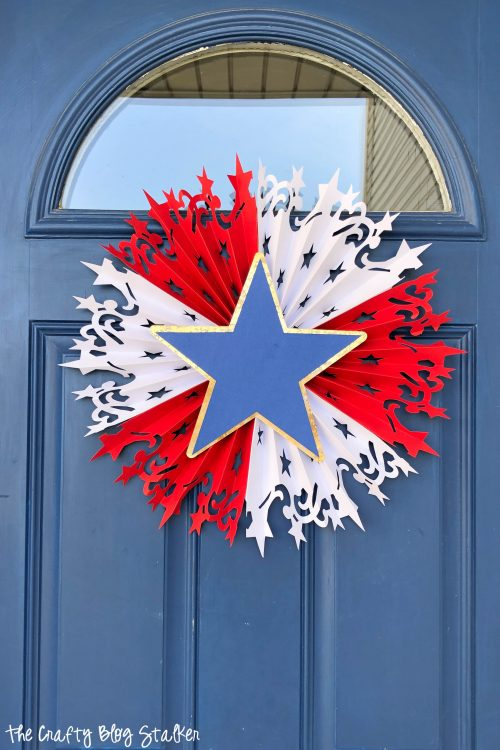 DIY Patriotic red white and blue rosette for front door decor