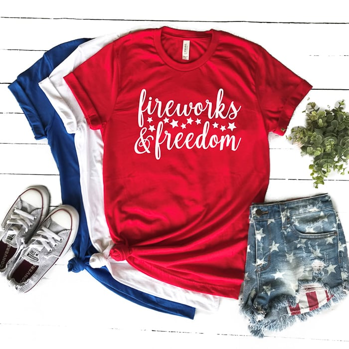 "A red t-shirt that says ""fireworks and freedom"""
