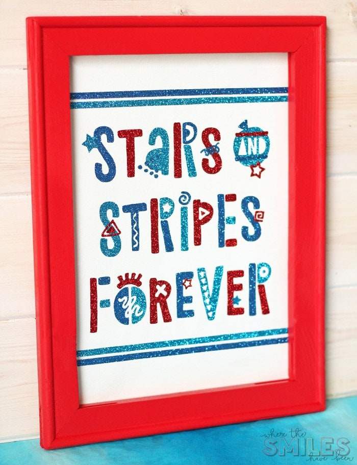 "A patriotic sign in a red frame. The sign reads ""Stars and Stripes Forever."""