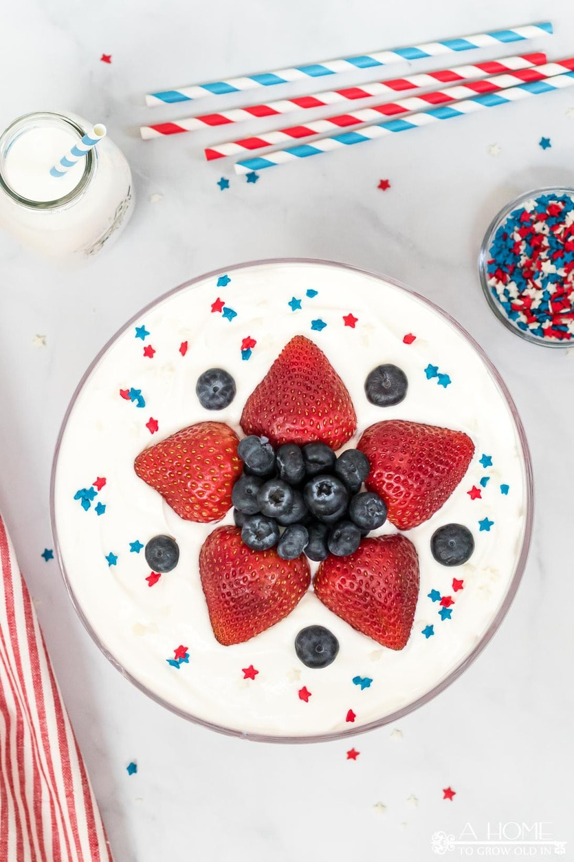 simple star decoration made with strawberries and blueberries on a patriotic trifle dessert